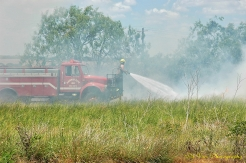 fire engine extinguishing grass fire